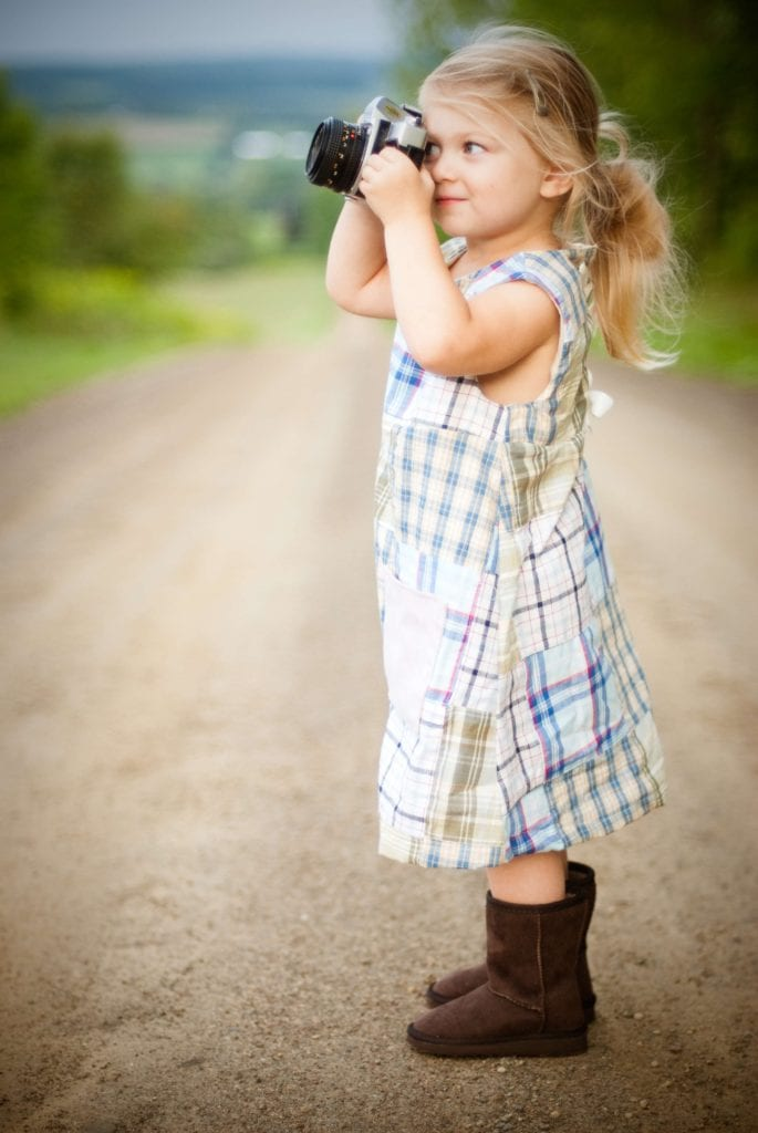 Photo: Young girl taking a photo